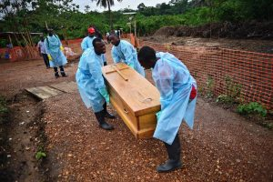 Emergency workers carrying coffins
