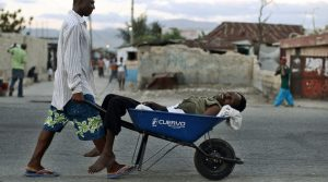 patient being carried by wagon