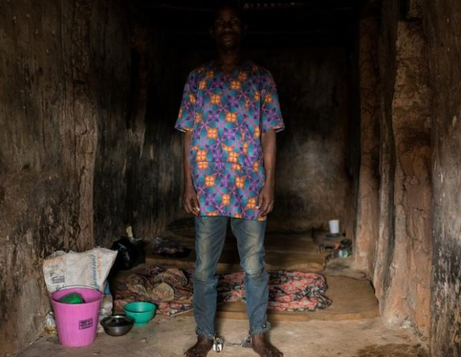 Image of a Nigerian man chained