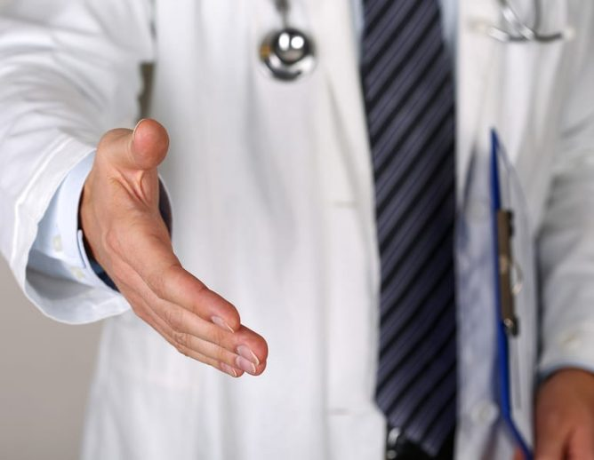 Doctor greeting hands