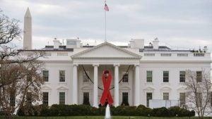 White house with HIV logo