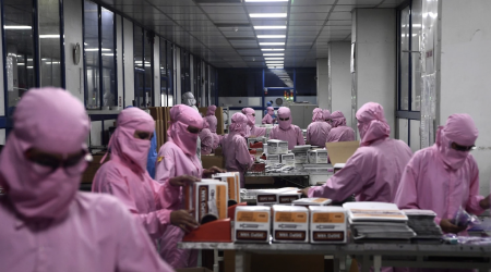 Workers in a vaccine manufacturing plant